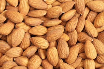 Background image of raw almond nut meats